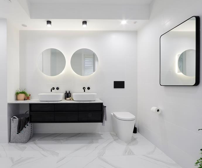 **Kerrie and Spence** The backlit circular mirrors completes the refined aesthetic of the bathroom.