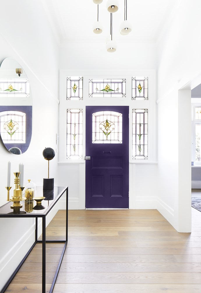 "**Entry** ""I do like a bit of wow factor,"" says Josie, ""so I went for a vibrant purple door in Eccentric Purple by Dulux."" Console, [Globewest](https://www.globewest.com.au/