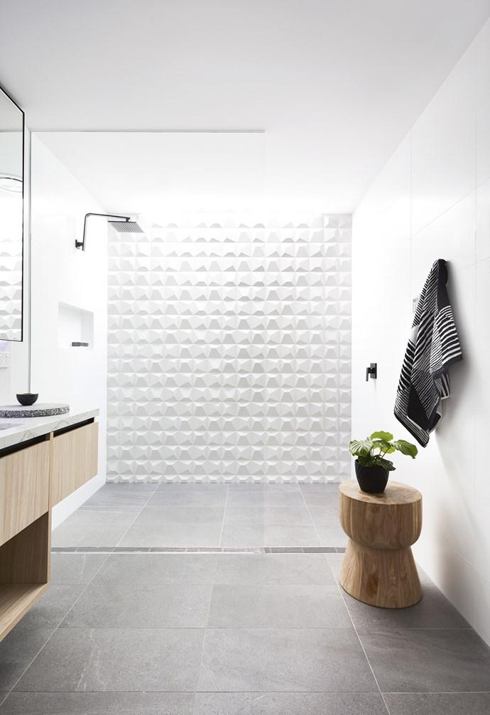 "**Kids' bathroom** A skylight and bright white 3D tiles keep the room fresh. Wow 'Nilo' wall tiles, [Signorino Tile Gallery](http://www.signorino.com.au/|target=""_blank""|rel=""nofollow""). Stool, [Fenton&Fenton](https://www.fentonandfenton.com.au/|target=""_blank""|rel=""nofollow"")."