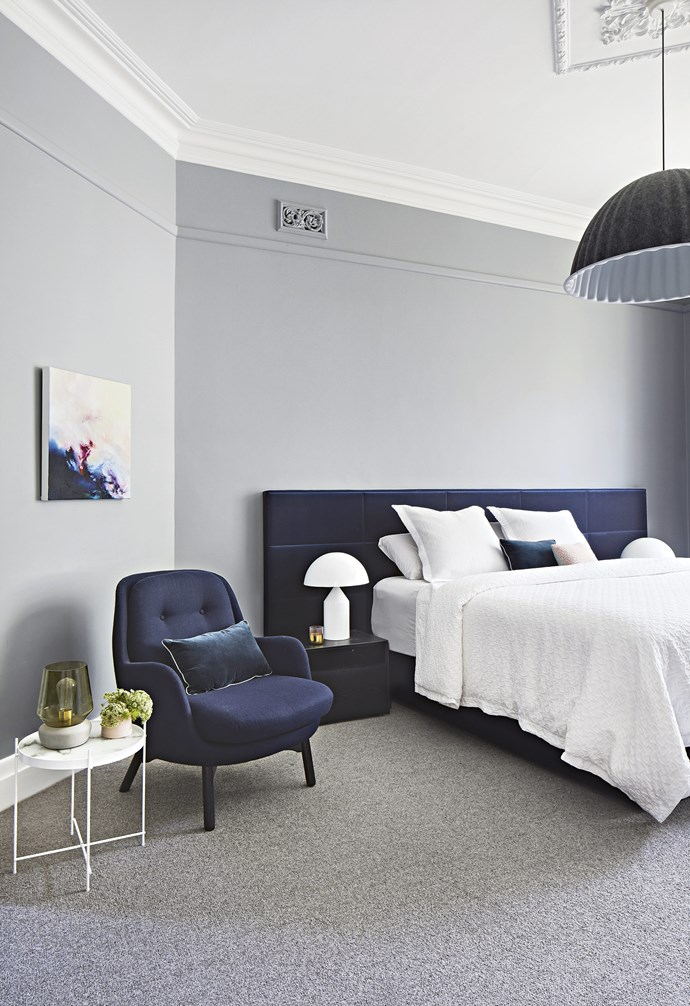 "**Master bedroom** A palette of soft grey, navy and white creates a tranquil mood. The oversized custom bedhead from Colleve adds drama and luxe texture. Walls painted in Endless Dusk, [Dulux](https://www.dulux.com.au/|target=""_blank""