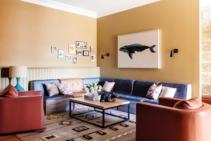 Comfy seating and a warm palette distinguish this informal space. 'Quadrant Soft' modular sofa, Koskela. 'Oscar' armchairs and 'Dari' rug, Jardan. 'Phoenix' coffee table, Urban Couture Design+Homewares. Designer Boys whale print, Boyd Blue.