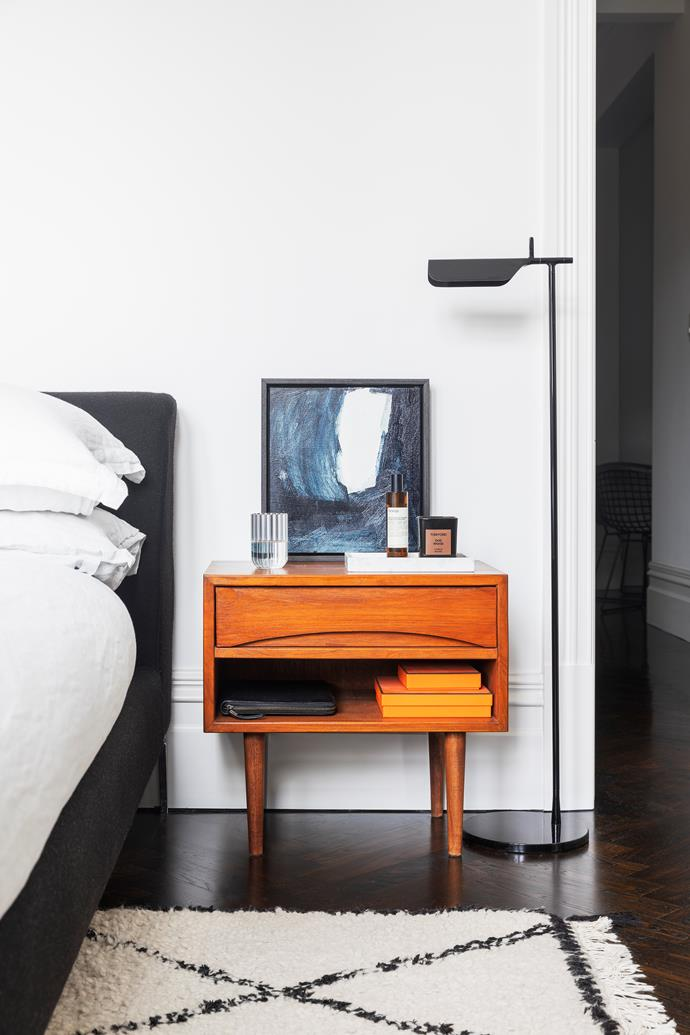 In the bedroom, an 'Alison' bed from Camerich. 'Tab' floor lamp from Euroluce. Artwork by Antonia Mrljak.