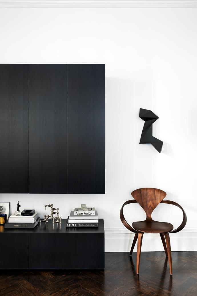Joinery in the living room is custom. Cherner chair from De De Ce. Sculpture by Dion Horstmans.
