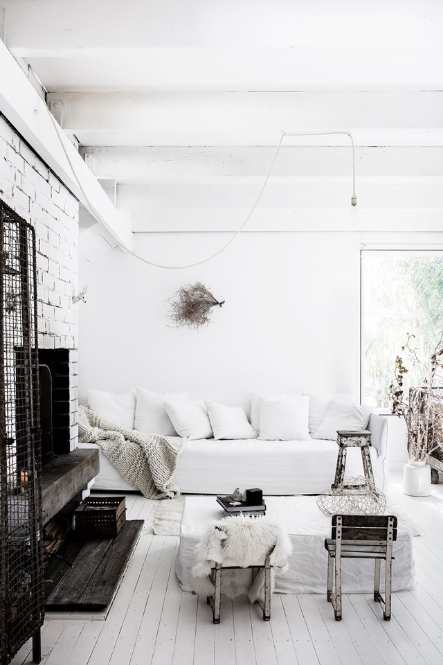 "Every surface of this [coastal meets French Provincial home](https://www.homestolove.com.au/coastal-french-provincial-home-7155|target=""_blank"") has been painted white. By bringing in some natural elements – timber, twigs, dried flowers, shells, ceramics – for warmth and visual interest, the home feels anything but cold and sterile. *Photo:* Maree Homer"