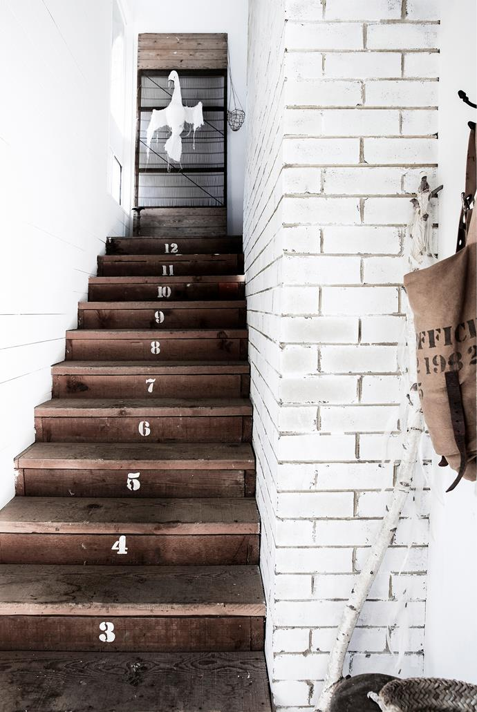 The couple used stencils from The Society Inc by Sibella Court to dress up the exposed timber staircase. At the top, a wall-mounted Tamar Mogendorff swan awaits.