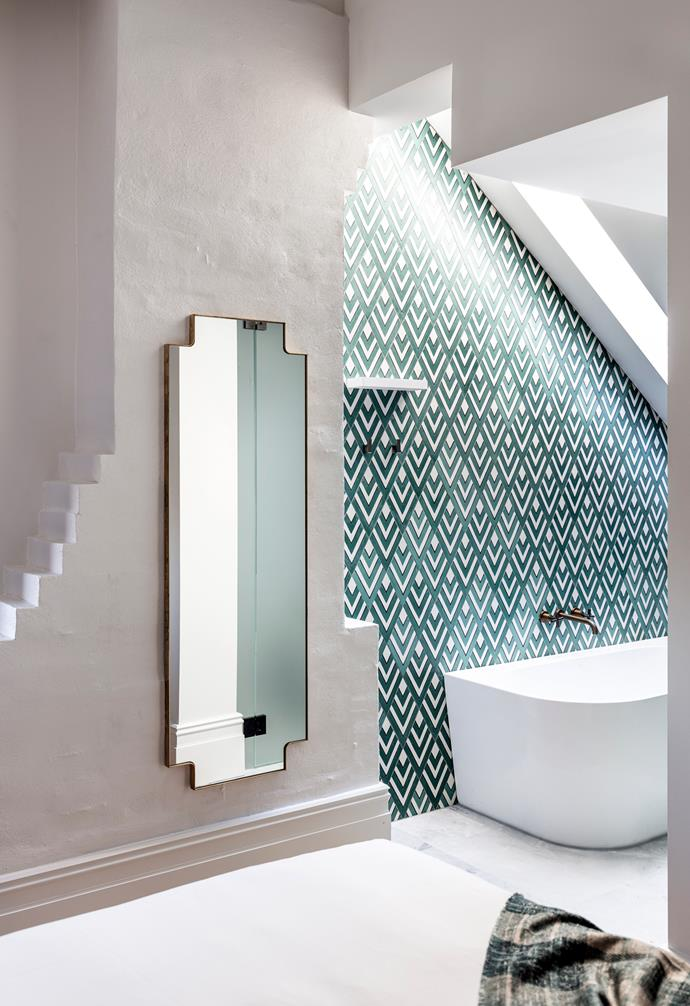 **Architectural details** If you're working with quirky architectural details in your home, highlight them instead of trying to ignore and hide them. The geometric mirror and tiles emphasise the angles in the room.