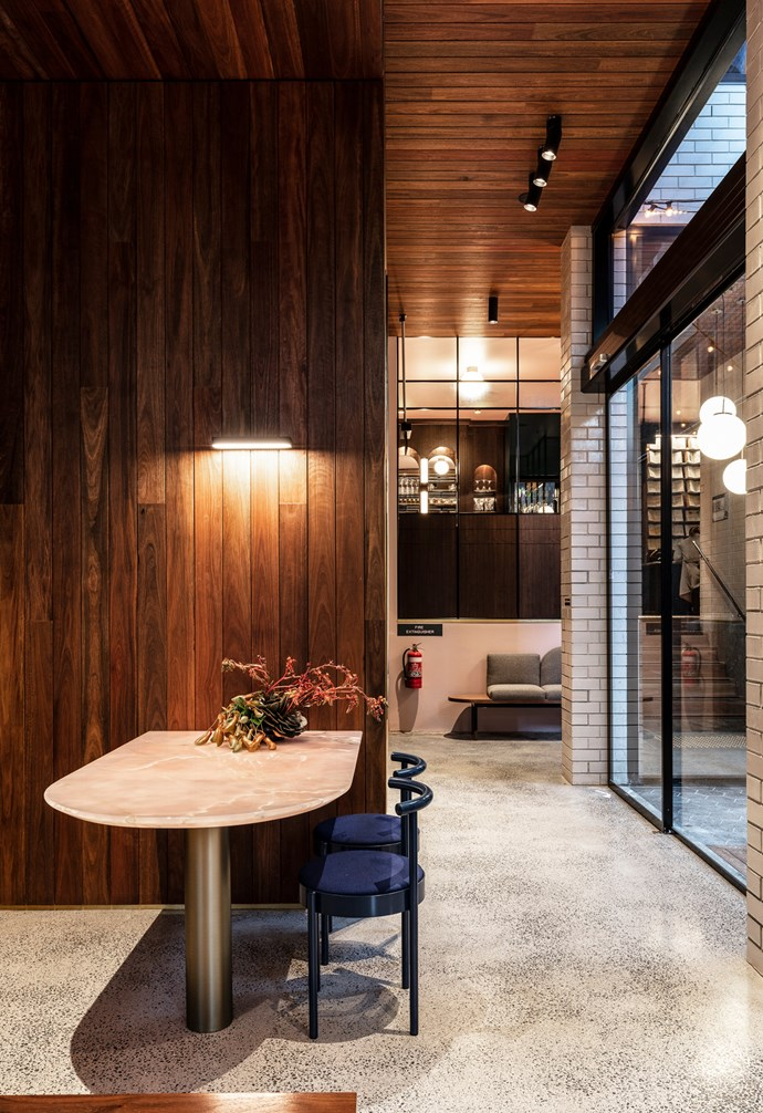 **Timber it up** The creative use of timber on the ceiling creates a cosy vibe in this space.