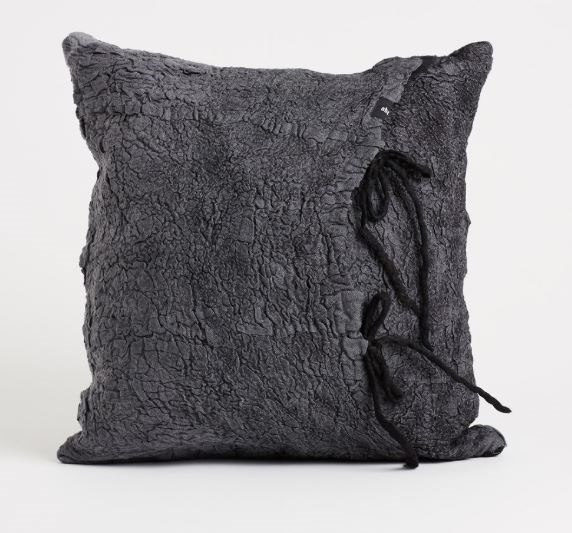 """'Otto' linen and merino wool **cushion** in charcoal, $238.50, from [Abode Living](https://fave.co/2vRaUPp target=""""_blank"""" rel=""""nofollow"""")."""