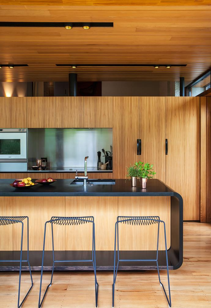 **Kitchen** Timber reigns supreme in the home, with steel and black details adding contrast within the kitchen.