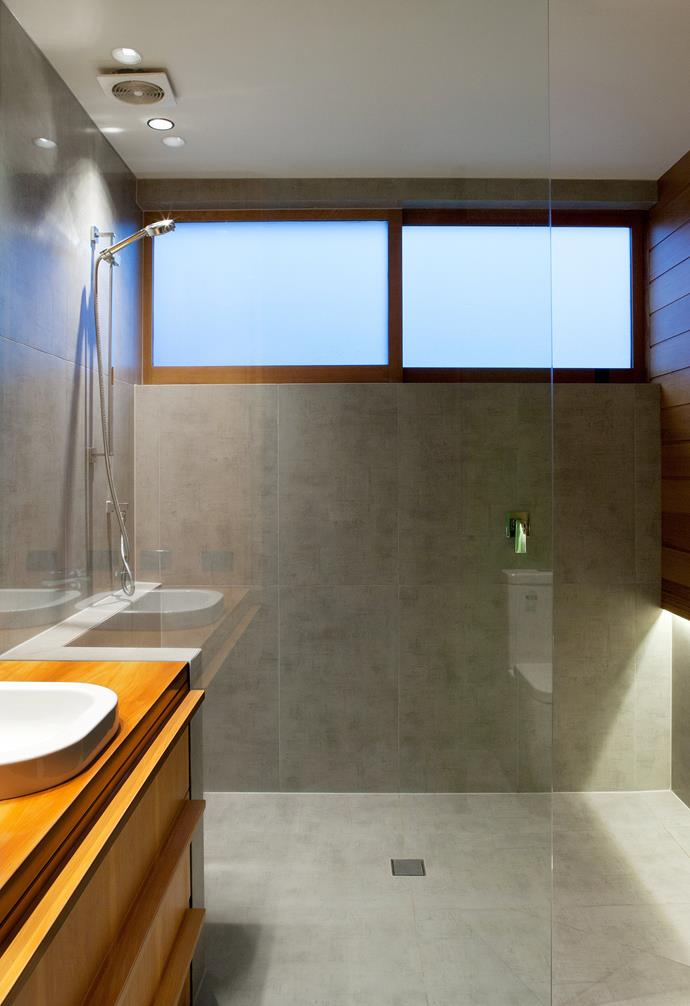 **Bathroom** Grey tiles transform the bathroom into a zen zone.