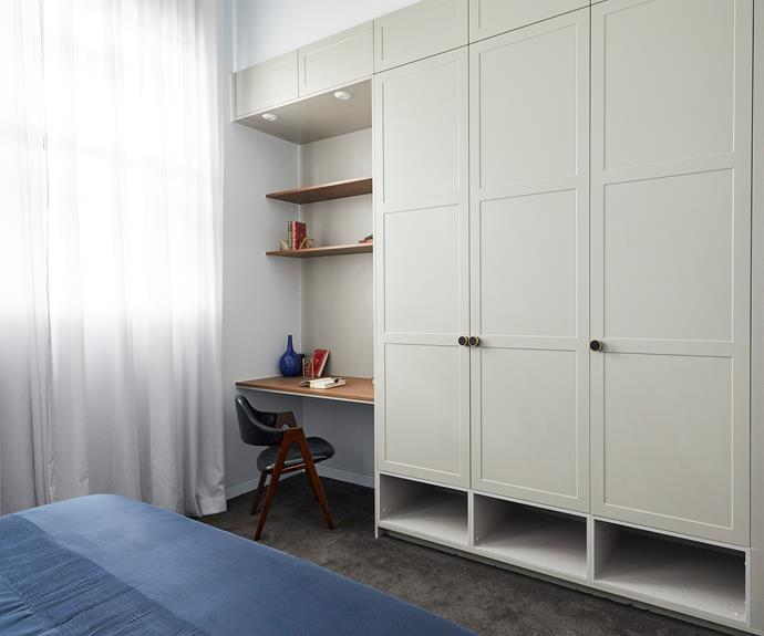 **Norm and Jess** Ample storage with shaker cabinet fronts line the wall opposite the bed.