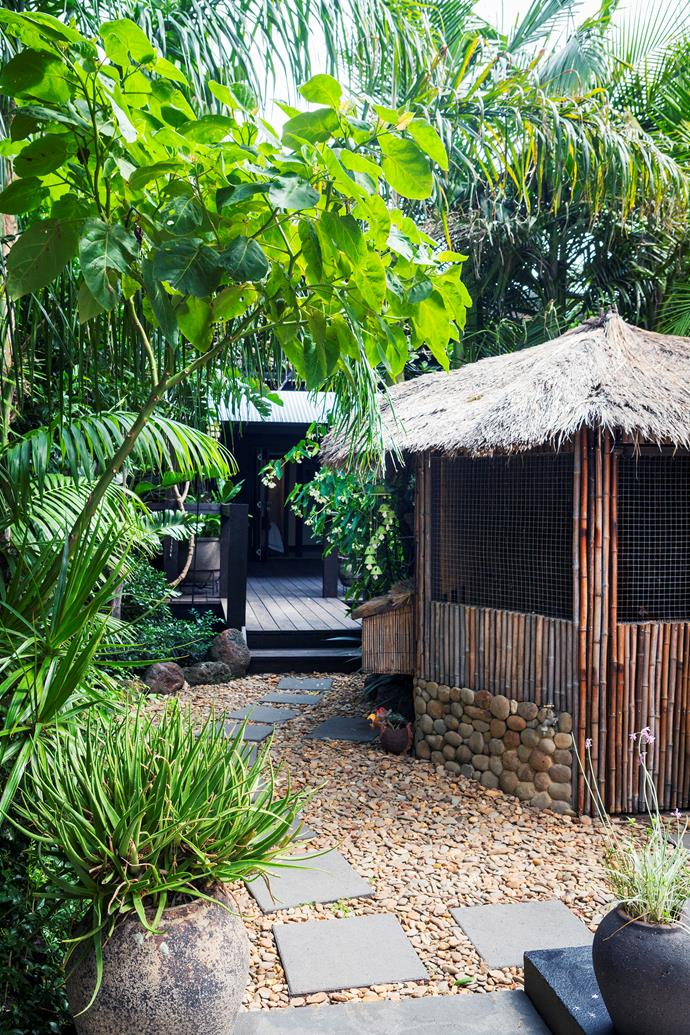 Even the chook pen, constructed from black bamboo, river pebbles and thatch, is in keeping with the tropical theme.