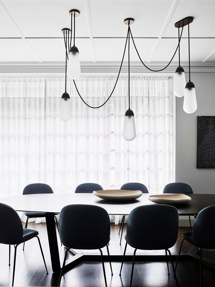 'Lariat 5' pendant in bronze from Apparatus Studio hangs over the Lowe Furniture 'Atticus' table from Hub.