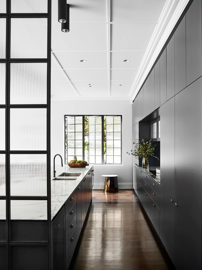 Tekna 'Nautic' ceiling tube lights from Tigger Hall Design. Custom-made fluted glass and steel doors. Franke 'Verona' tap from Winning Appliances. 'Super White Dolomite' honed marble from CDK Stone.