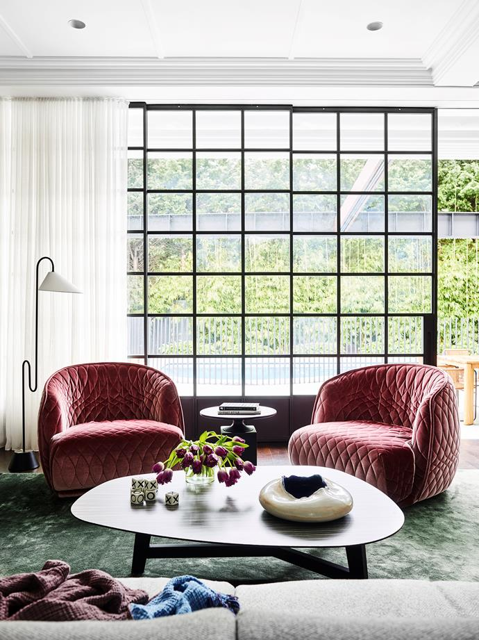 ClassiCon 'Roattino' floor light by Eileen Gray from Anibou. Moroso 'Redondo' armchairs in pink velvet and Moroso 'Phoenix' coffee table all by Patricia Urquiola from Hub.
