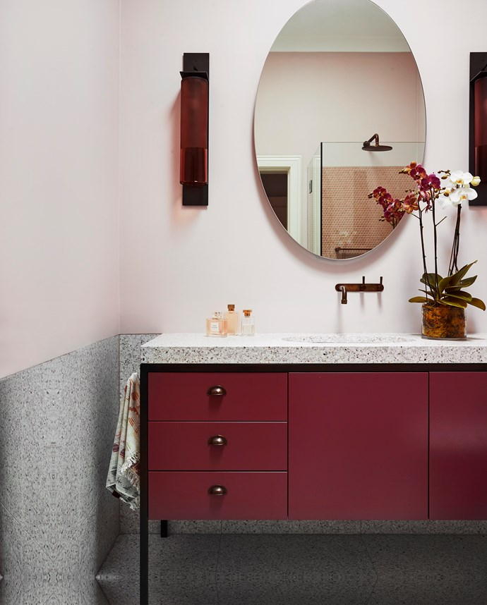 In the powder room, 'Heart' mirror from Nicholas & Alistair. 'Fizi' sconces from Articolo. Brodware 'Yokato' tap from Cass Brothers. TeknoForm 'Pittella Rapolano 35' basin in Anthracite travertine from Sydney Tap and Bathroomware. Fibonacci Stone 'Idol' benchtop from Onsite. I