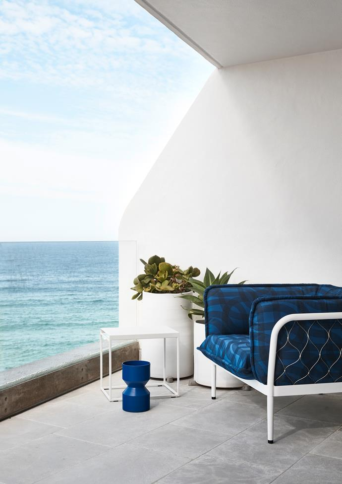 "The home enjoys sweeping ocean views, which the owner can enjoy from the 'Trace' armchair from [Tait.](https://madebytait.com.au/product/trace-armchair/?cn-reloaded=1|target=""_blank""