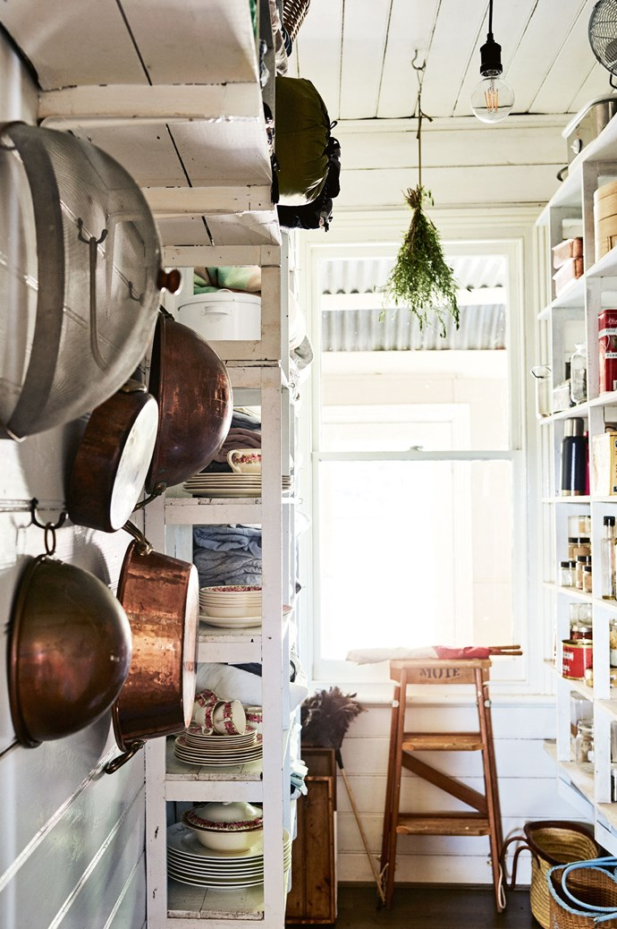 """Copper pots hang in the laundry. Annie and Susan also [grow their own produce](https://www.homestolove.com.au/how-to-start-a-vegetable-patch-5108 target=""""_blank"""") on the property. """"We have heritage tomatoes, beans, carrots, witlof, eggplant, peppers, chilies, chard... At first we weren't sure what we could grow in this soil but we have this legendary potato soil a metre deep!"""" says Annie."""