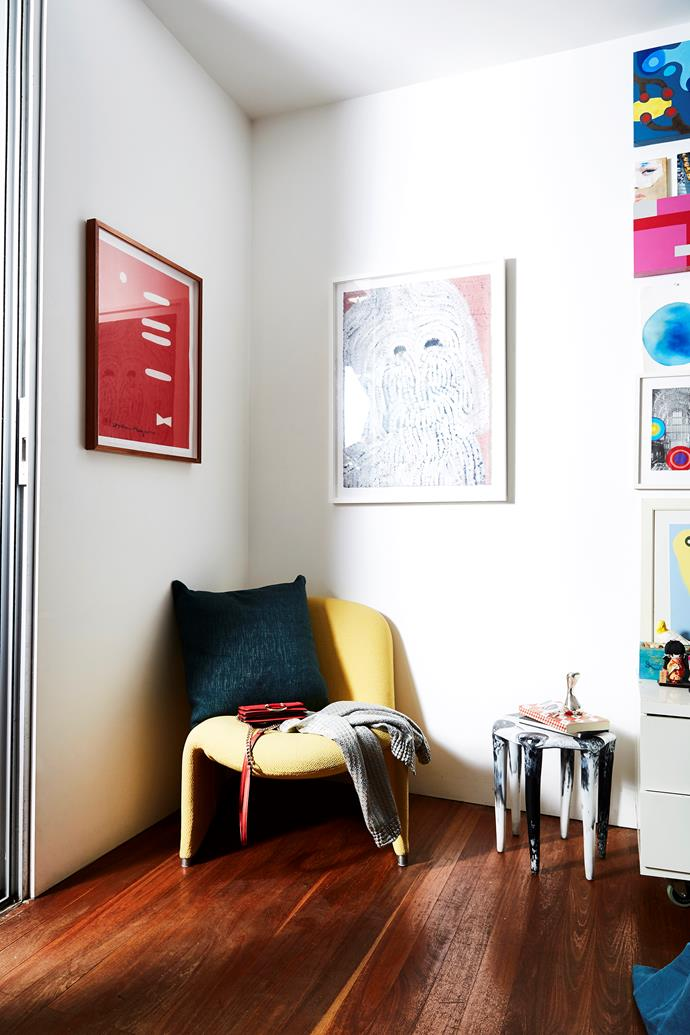 A cosy corner adorned with art.