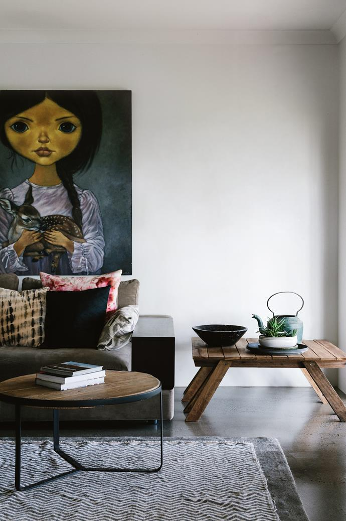 An oil-on-sand painting by MRBT, found in Bangkok, hangs in the television room. The side table was made using an old pallet.  *Photography: Marnie Hawson | Styling: Nicola Sevitt*