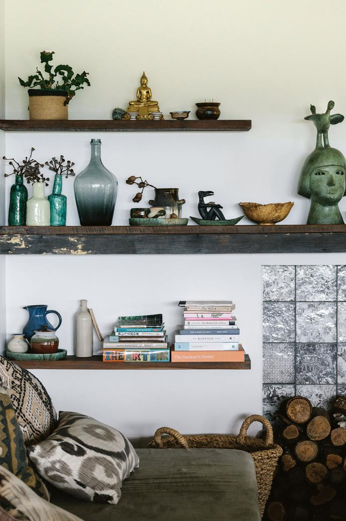 The living room shelves hold treasures Matt and Palisa have collected on their travels. *Photography: Marnie Hawson | Styling: Nicola Sevitt*