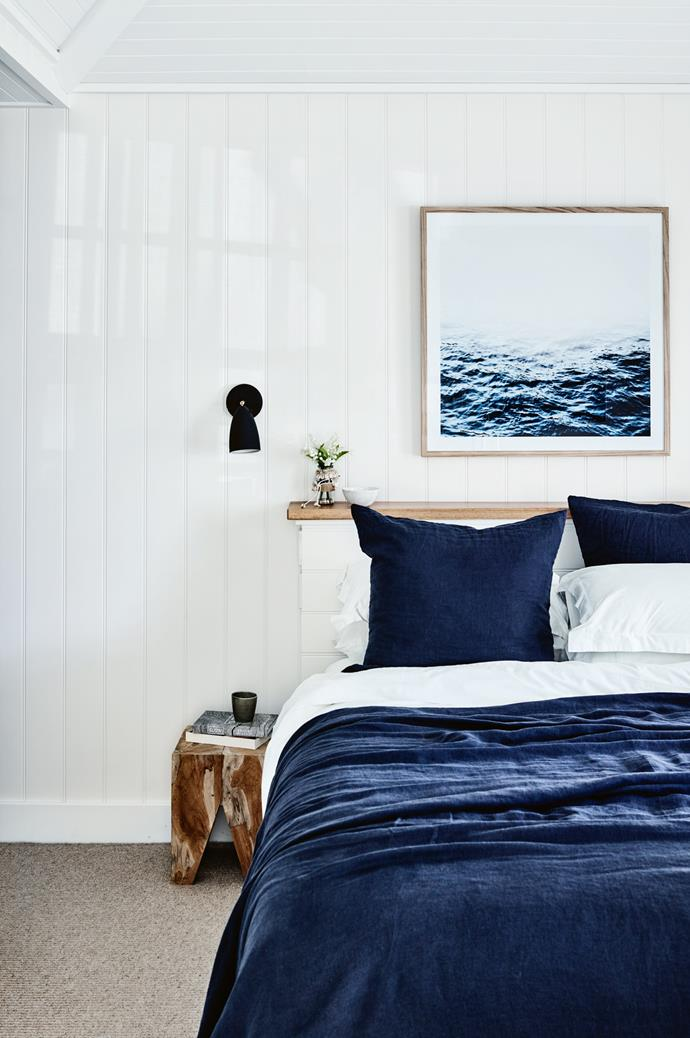 "This bedroom is decorated with artwork from [Design Twins](https://www.designtwins.com/|target=""_blank""