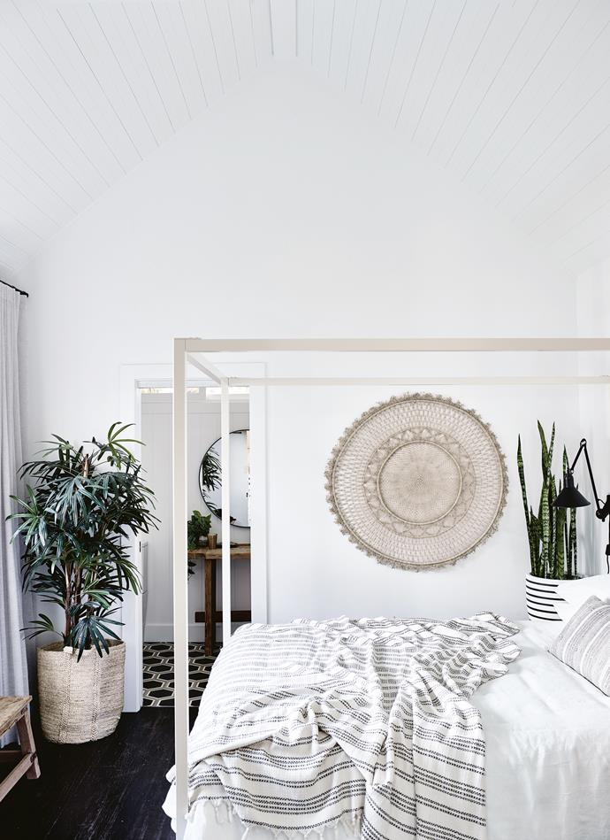 "In the Soul Barn's bedroom, a four-poster bed from Incy Interiors is dressed with linen from [The Beach People](https://thebeachpeople.com.au/|target=""_blank""