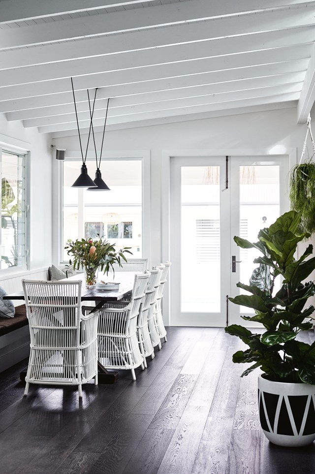 "<P>**CRISP AND LAID BACK**<p> <P>In this [coastal farmhouse in Gerringong](https://www.homestolove.com.au/coastal-farmhouse-reno-gerringong-18827|target=""_blank"") a set of white wicker dining chairs really stands out against dark hardwood floors. It is the contrast of tones that gives this space its airy, modern feel. A [large leafy fiddle leaf fig](https://www.homestolove.com.au/large-indoor-plants-6637