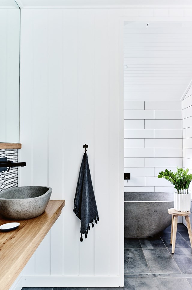"In this bathroom, relaxed textures such as stone and timber have been paired with features quintessential to a country aesthetic, including subway tiles and [beadboard panelling](https://www.homestolove.com.au/kitchen-cabinet-door-styles-7021|target=""_blank""). *Photo: Mark Roper / Styling: Jessica Hanson / Story: Country Style*"