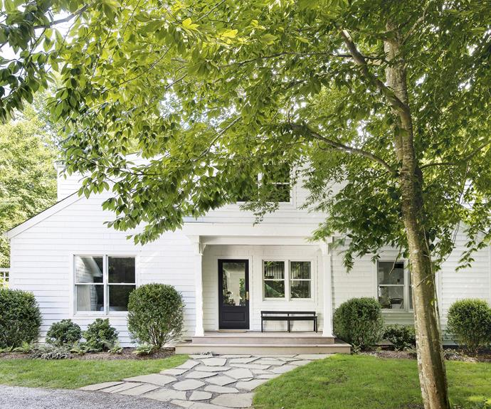 **Exterior** An all-white paint job, new windows and a new front porch have done wonders for homeowners Andrea and Adam's getaway.