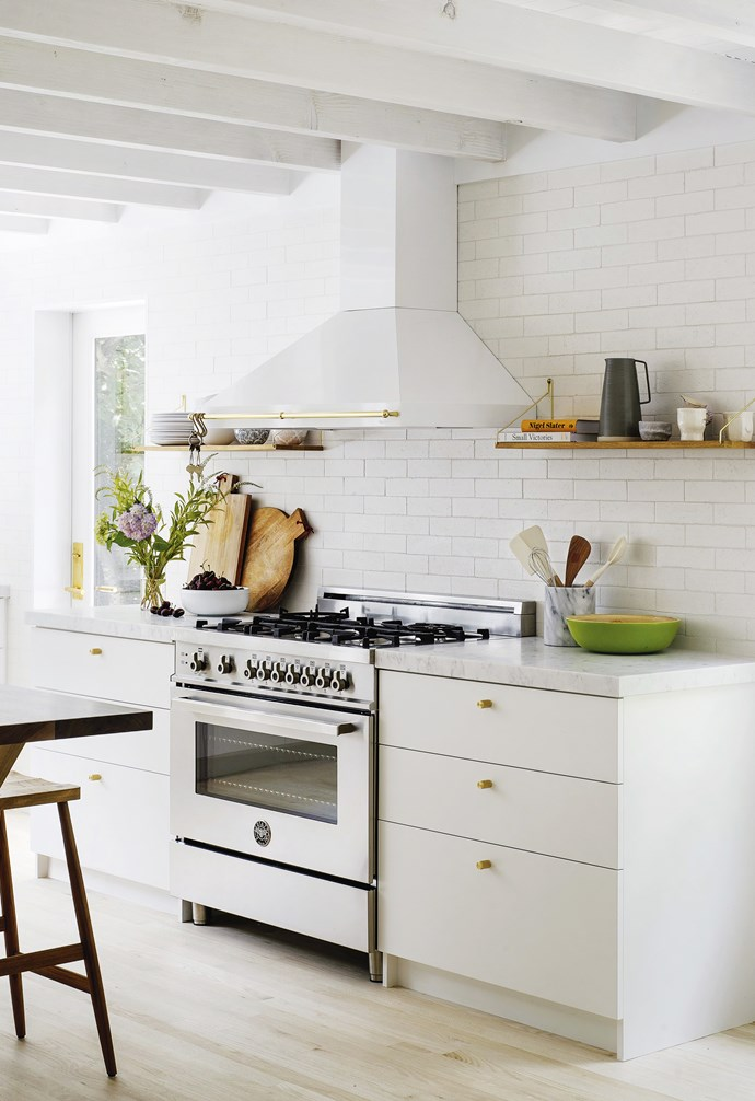 **Kitchen** The rustic look comes through in simple painted cabinetry with a marble benchtop, bleached oak floors and a subway-tiled wall, offset by a Bertazzoni cooker and rangehood.