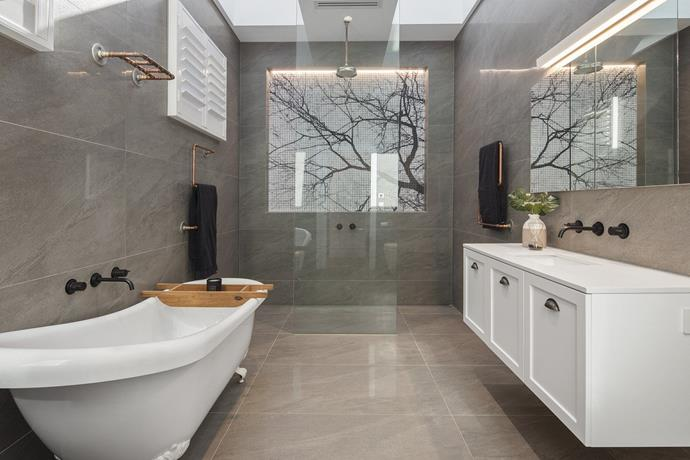 """Simple finishes keep the [mosaic tile](https://www.homestolove.com.au/bathroom-renovation-mosaic-masterpiece-1641 target=""""_blank"""") feature the hero of the room. *Photo: Domain*"""
