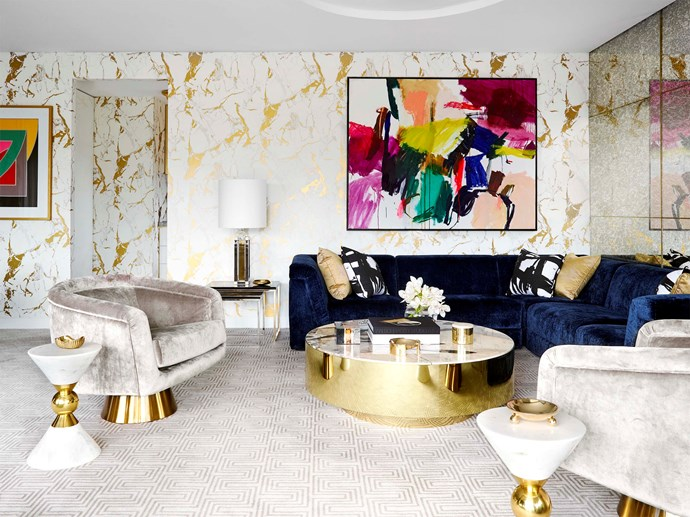 """Jonathan Adler sofa and armchair. Patterned cushions, coffee table, table lamp, nesting tables and rug by [Greg Natale](https://shop.gregnatale.com/