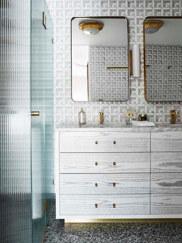 "Panes of crystal clear glass have reigned supreme in bathrooms over the past decade, but privacy glass could soon change that! This bathroom in [Greg Natale's Darlinghurst apartment](https://www.homestolove.com.au/inside-interior-designer-greg-natales-darlinghurst-apartment-18842|target=""_blank"") is a case in point. It also happens to feature [terrazzo flooring](https://www.homestolove.com.au/terrazzo-bathrooms-19359