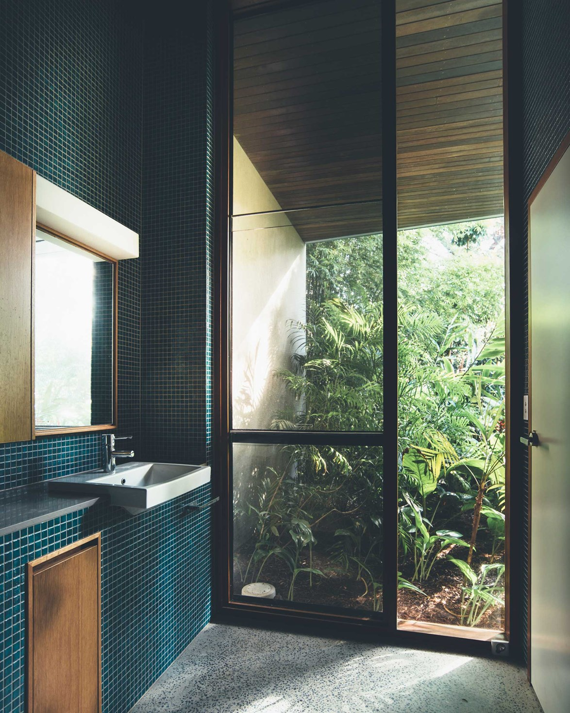 "The finishes used in this Japanese-inspired bathroom were informed by the owner's desire for a [low-maintenance, durable beach house](https://www.homestolove.com.au/beach-house-noosa-queensland-little-cove-18846|target=""_blank""). A hardy terrazzo floor fit the bill perfectly. *Photo: Teeland Architects / Jared Fowler / Story: Home Life*"
