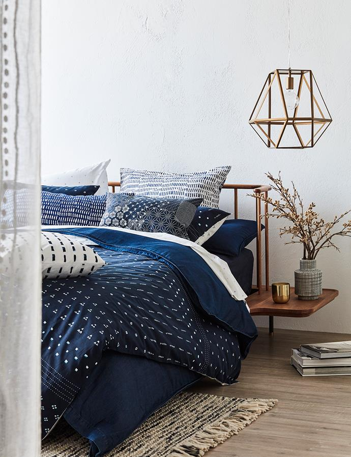 "SHOP: Linen House Omari queen quilt cover set in indigo, $179; European pillowcase, $49; 35x55cm cushion, $49; 48x48cm cushion, $49; [Aura Denim queen quilt cover set in indigo](https://www.domayne.com.au/aura-denim-indigo-quilt-cover-set-queen.html target=""_blank"" rel=""nofollow""), $299; Domayne Luxuries 300TC queen sheet set in indigo, $109; white, $109; Linen House Omari 35x55cm cushion in indigo, $49; 48x48cm cushion in indigo, $49; Distrikt queen bed frame, $4999."