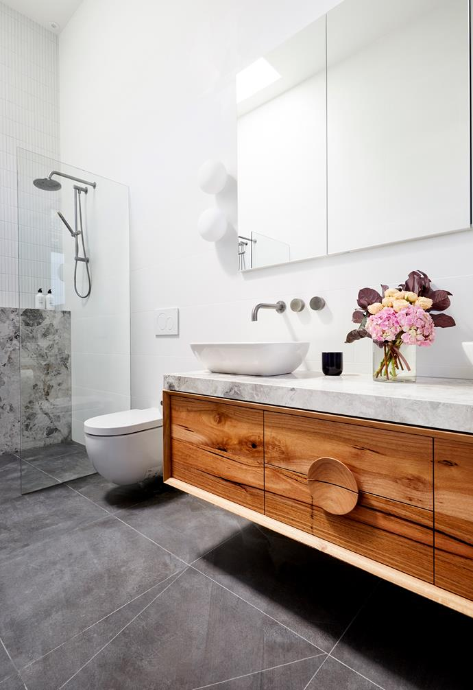 **Bianca and Carla** A common design highlight in all their rooms so far, the timber vanity from Ingrain makes a design statement in this ensuite.