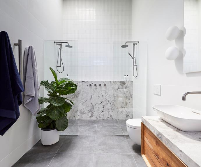 **Bianca and Carla** A slab of dolomite echoes the stone feature wall of their main bathroom.