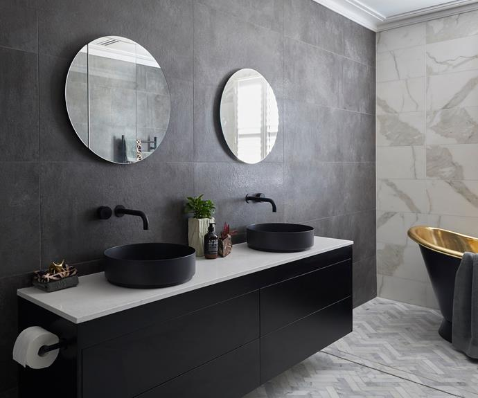 **Hayden and Sara** Dark walls meets herringbone floors and a lighter feature wall in this ensuite.