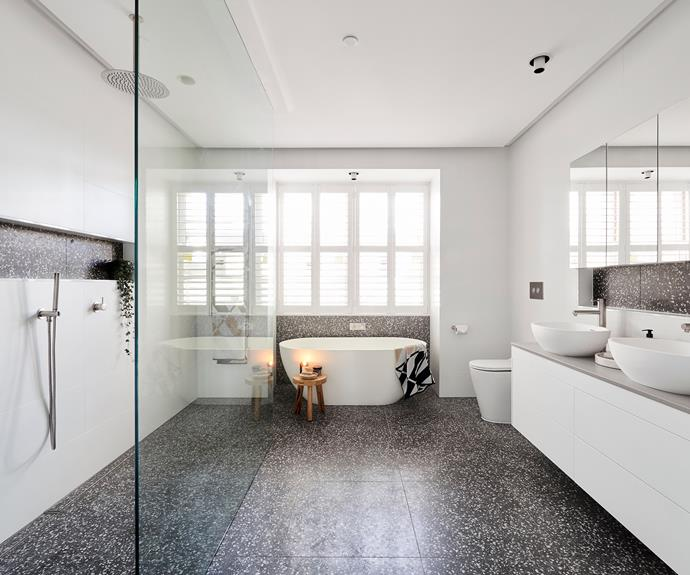 **Courtney and Hans** The dark terrazzo tile echoes the lighter terrazzo used in their main bathroom.