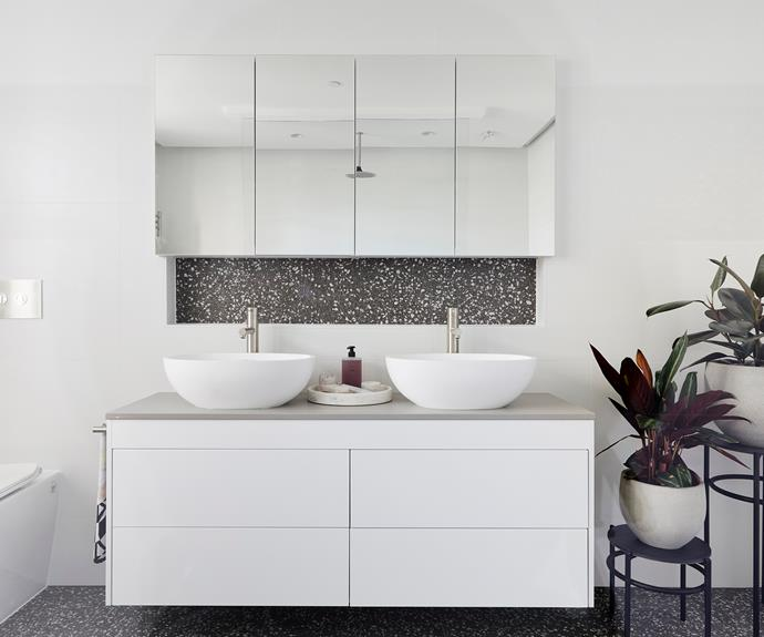 **Courtney and Hans** The darker terrazzo pops against a mostly white palette.
