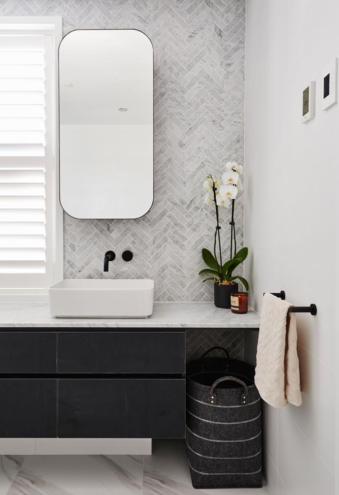 **Kerrie and Spence** The marble tiles on the floor are the same as those the couple used in their main bathroom.