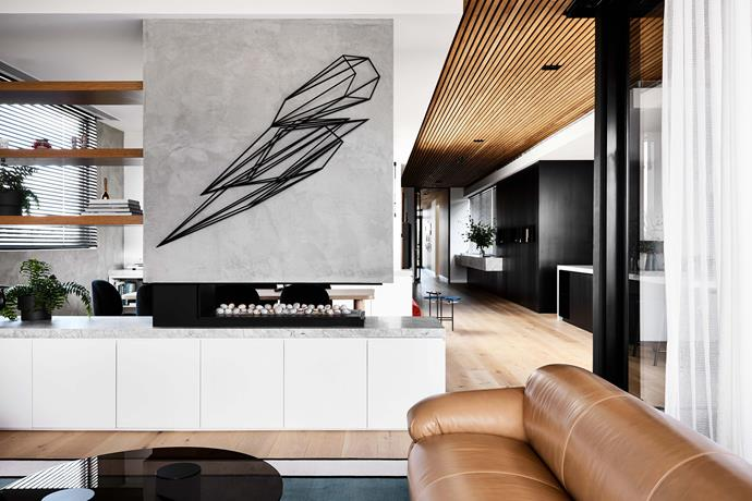 A Dion Horstmans wall sculpture points the way in the living space.