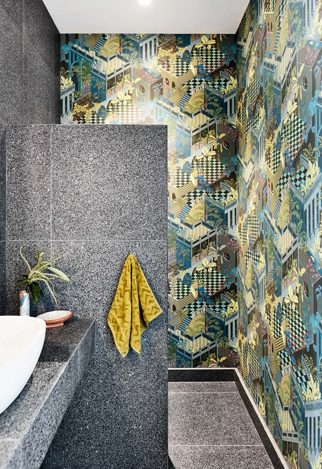 "Refined sophistication dominates the look of this [Melbourne penthouse apartment](https://www.homestolove.com.au/a-sophisticated-entertainers-penthouse-in-brighton-18857|target=""_blank"") but in the bathroom, a more playful style emerges. Between the geometric wallpaper and floor-to-ceiling terrazzo, this space is a feast for the eyes. *Photo: Derek Swalwell / Story: Belle*"