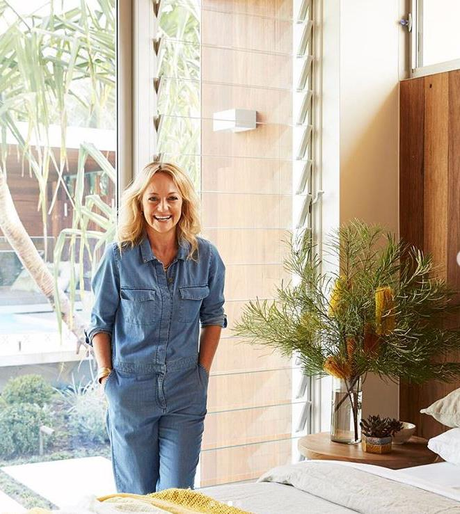 "Shelley is all smiles in her breezy [garden studio](https://www.homestolove.com.au/shelley-craft-byron-bay-garden-studio-19277|target=""_blank""), where mustard yellow accents create a cheery environment."