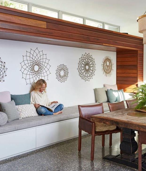 Handwoven mandalas from Weaving Nature turn a basic built-in bench seat into a zen retreat.