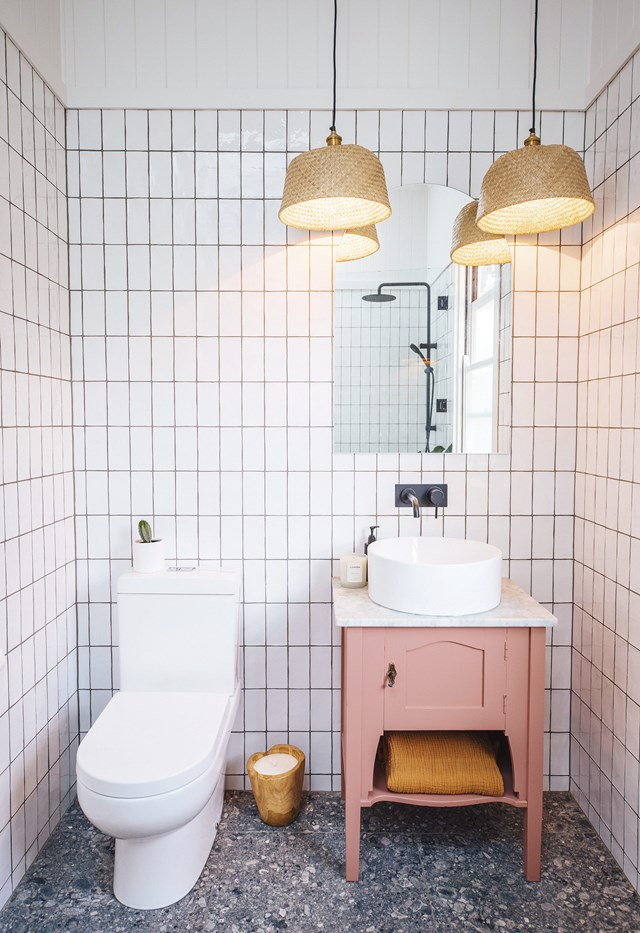 "Terrazzo-look tiles give this compact powder room in a [revived Brisbane home](https://www.homestolove.com.au/a-pair-and-a-spare-revived-a-brisbane-fixer-upper-18866|target=""_blank"") an instantly youthful feel, while a millennial pink washstand adds a fun splash of colour. *Photo: [A Pair and Spare](https://apairandasparediy.com/