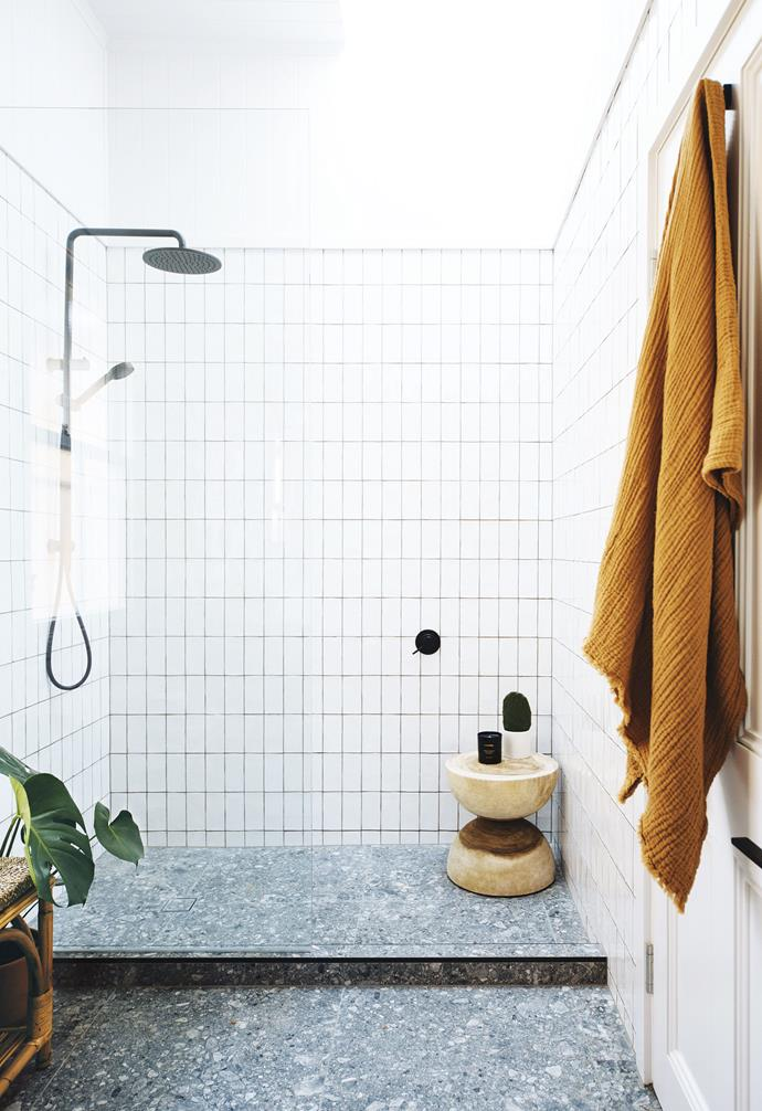 **Bathroom** For consistency, Geneva and Ben used the same materials and finishes here as in their ensuite. The extra touches are a wood stool from The Bach Living, an H&M Home towel and a Lumira candle.