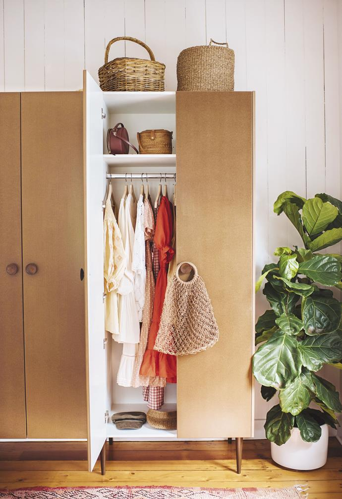 """**DIY tip** Repurpose and rejoice. """"We wanted simple storage that didn't cost a bomb,"""" says Geneva. """"These mid-century-style wardrobes are made out of Kaboodle pantry cabinets with custom legs on the bottom."""" 'F402' wardrobe doorknobs, [Kethy](https://www.kethy.com.au/
