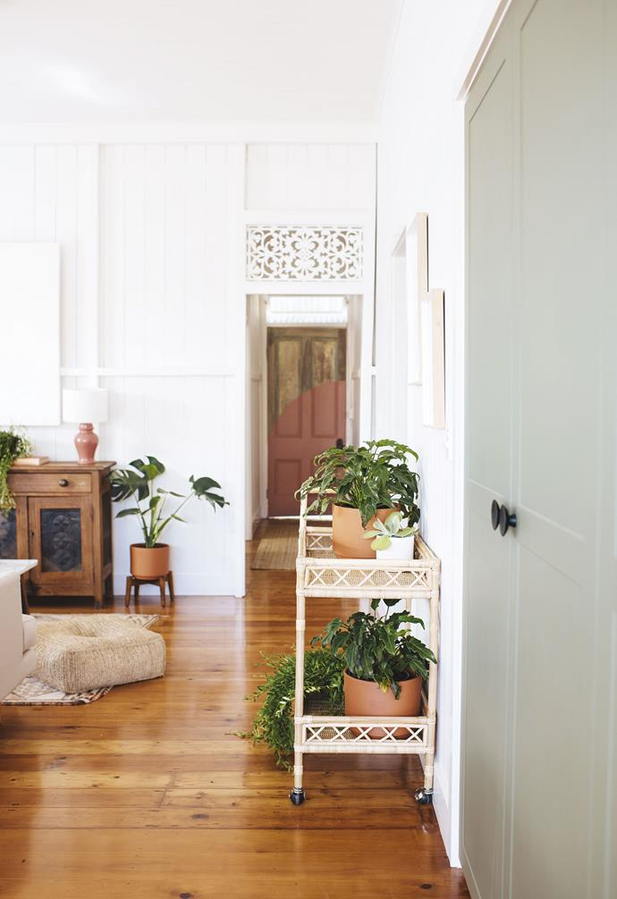 """**Entry** The playful pink arc on the front door was repeated inside. """"It contrasts with the straight lines elsewhere,"""" says Geneva. """"We used string and a pencil  to draw the rounded edge, then painted it with three coats of paint. We love how it looks!"""""""